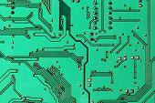 Green Electronic Microcircuit Taken Closeup.