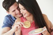 Studio Shot Of Couple Eating Crumpets