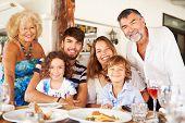 Multi Generation Family Enjoying Meal In Restaurant