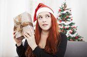 Girl Is Shaking Happy Christmas Present
