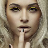 Fashion photo of beautiful woman with bright makeup