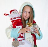 Happy little girl with Christmas presents