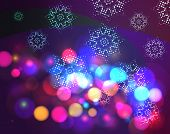 Bokeh effect christmas background with snowflakes