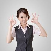 Asian business woman give you OK gesture, close up portrait