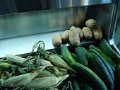 Corn, potatoes, and cucumbers at market