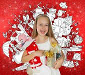 Little girl holding Christmas presents and doodle background with lots of toys