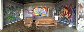 Abandoned Urban Building With Graffiti And Willful Damage. Panorama