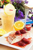picture of crepes  - vanilla cheese crepe and strawberry jam topping with cool ginger lemon juice background ready to eat on top table - JPG
