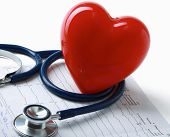 Red heart and a stethoscope on cardiagram
