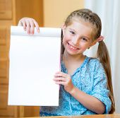 Close up portrait of a young girl holding blank sign