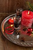 Christmas background with liquor spices candles and fir branches