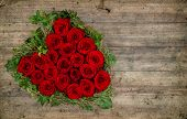 Heart Shaped Red Roses Bouquet On Rustic Wooden Background