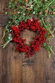 Christmas Tree Branches And Wreath From Red Berries. Festive Decoration