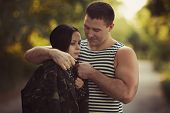 stock photo of prison uniform  - Woman and soldier in a military uniform say goodbye before a separation - JPG