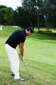 Successful attractive man playing golf on holidays