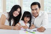 Cheerful Parents Help Their Child Studying