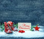 Christmas Decoration Red Stars And Antique Baby Shoes In Snow