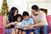 Happy Family Hold A Story Book
