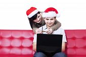 Isolated Christmas Couple Shopping Online
