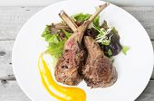 Grilled Lamb Chops On A Bed Of Vegetables