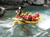 stock photo of raft  - White water rafting on the rapids of river Soca - JPG