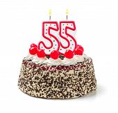 Birthday cake with burning candle number 55