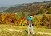 pic of asheville  - Woman photographer in the mountains forest in autumn - JPG