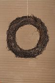 Round Christmas Wreath Natural Twigs On Old Cardboard Background