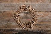 Round Christmas Wreath Natural Twigs On Old Rustic Background