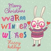 Warm winter wishes card in vector. Funny Merry Christmas background. Funny cartoon rabbit in sweater