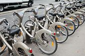 Row Of Gray City Public Bicycles For Rent