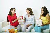 Pregnant women on sofa