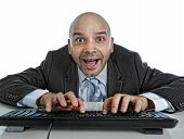 Businessman Typing On Computer Keyboard With Funny Face Expressi