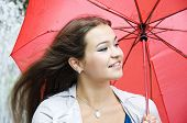 Smiling Young Girl With A Red Umbrella