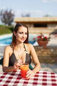 Brunette Woman In Bikini With Fresh Juice