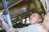 Man Making Incline Press - Workout Routine .