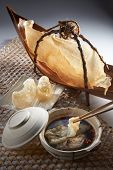 stock photo of raw materials  - Fish maw soup table set with clay pot and raw material - JPG