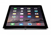 Angled Front View Of Apple Space Gray Ipad Air 2 With Ios 8 Lies On The Surface, Designed By Apple I