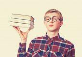 pic of nerd glasses  - Nerd guy in glasses with books - JPG