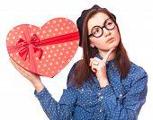 foto of nerd glasses  - Nerd girl in glasses with heart shape gift - JPG