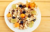 oat muesli or oatmeal with grape, blueberry and physalis