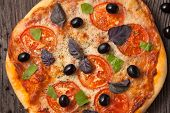 Italian Pizza Margherita With Tomatoes, Pepper, Olives And Basil On Vintage Rustic Background Close