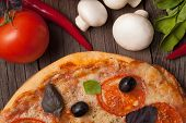 Pizza Margherita With Tomatoes, Pepper, Olives And Basil On Vintage Rustic Background Close Up