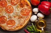 Pizza Margherita With Tomatoes, Olive Oil And Mushrooms Close Up On Rustic Background