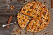 A Piece Of Sliced Apple Pie With A Metal Spatula On Vintage Wooden Background