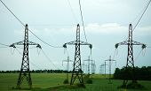 Pillars Of Line Power Electricity On Green Field, Beyond The Horizon