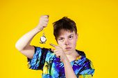 Teenage Boy With Watch Showing Time
