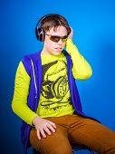 Affective Teenage Boy Listening Music In Headphones