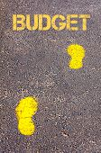 Yellow Footsteps On Sidewalk Towards Budget Message