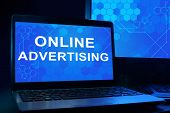 Computer with words Online Advertising.